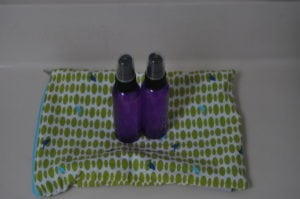 Plastic bottles with solution for the diaper bag- placed in a small wet bag with cloth wipes to prevent leakage in the bag.